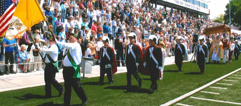 Fourth Degree Knights of Columbus march in formation behind Hibernian flag bearers during the 2009 Family Rosary Rally at Elder High School. Beginning with this year's event, the Purcell Council of the Knights will begin to take over planning the event. (Courtesy Photo)