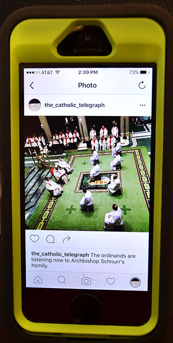 A post from The Catholic Telegraph's Instagram account is show on an iPhone.