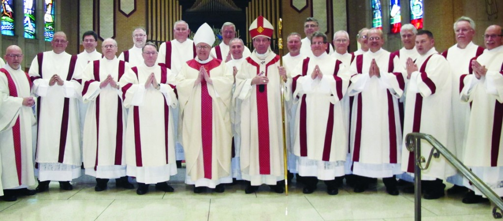 New permanent deacons of the Archdiocese of Cincinnati pose with Auxiliary Bishop Joseph Binzer, center left, and Archbishop M. Dennis Schnurr, center right, April 30 at our Lady of the Immaculate Conception Parish in Dayton.  (CT Photo/Jeff Unroe)