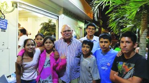 Paul Lammermeier with some of the children he has saved from the streets in Peru. (Courtesy Photo)