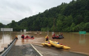 Emergency crews take out boats on a flooded I-79 June 24 after flooding in Kanawha, W.Va. The floods have killed at least 26 people, including a 4-year-old and an 8-year-old. As of June 27, almost 500,000 people were without power and 44 counties were under a state of emergency. (CNS photo/West Virginia Department of Transportation handout via Reuters)