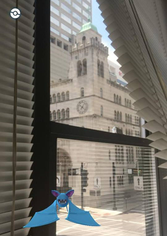 "A Pokemon creature known as a Zubat appears in the office of The Catholic Telegraph, across the street from St. Louis Church in downtown Cincinnati. In the game Pokemon GO, creatures from the came ""appear"" in the real world via mobile phone cameras. (CT Photo/John Stegeman)"