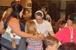 Members of St. Mary's Latino community express gratitude to Sister Maria