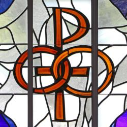 """A pair of wedding bands symbolizing the sacrament of marriage is depicted in a stained-glass window at St. Patrick Church in Smithtown, N.Y. Pope Francis' postsynodal apostolic exhortation on the family, """"Amoris Laetitia"""" (""""The Joy of Love""""), was released April 8. (CNS photo/Gregory A. Shemitz)"""