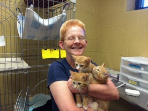 Sister Eileen holds three of the kittens she fostered and socialized. (Courtesy Photo)
