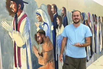 Cincinnati area artist John McCoy is painting the images of more than 62 saints at All Saints Parish in Alpena, Mich., where three parishes have been combined. McCoy, 24, had launched a freelance art career with the commission. (Courtesy Photo)