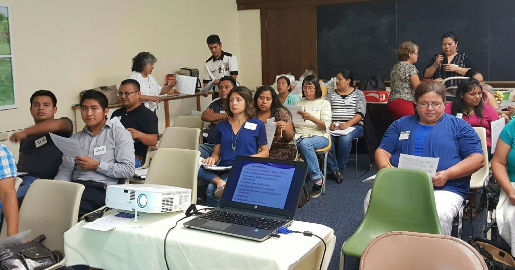 Hispanic adults students are shown attending a Catholic Social Teaching formation program recently. (Courtesy Photo)