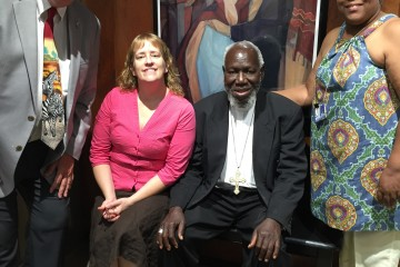 Bishop Emeritus Paride Taban poses with staff members from the archdiocesan Mission Office. Pictured with him from left are Mike Gable, Teresa Phillips and Melonise Knight. (Courtesy Photo)