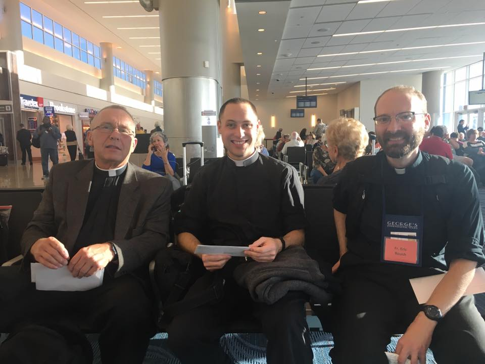 Awaiting the flight in Atlanta at Hartsfield International are Father Jan Schmidt, Father Timothy Fahey, and Father Eric Roush.