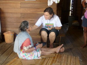 Sister Rebeca Spires, who has served in the Brazilian interior since 1970, tends to a blind woman. (Courtesy Photo)
