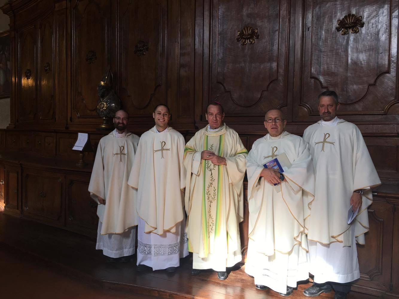 From Left to right, Fr. Roush, Fr. Fahey, Archbishop Schnurr, Fr. Schmidt, and Fr. Kunst prepare for Mass at St. Dominic Basilica in Siena Italy (Courtesy Photo)in Siena Italy (Courtesy Photo)