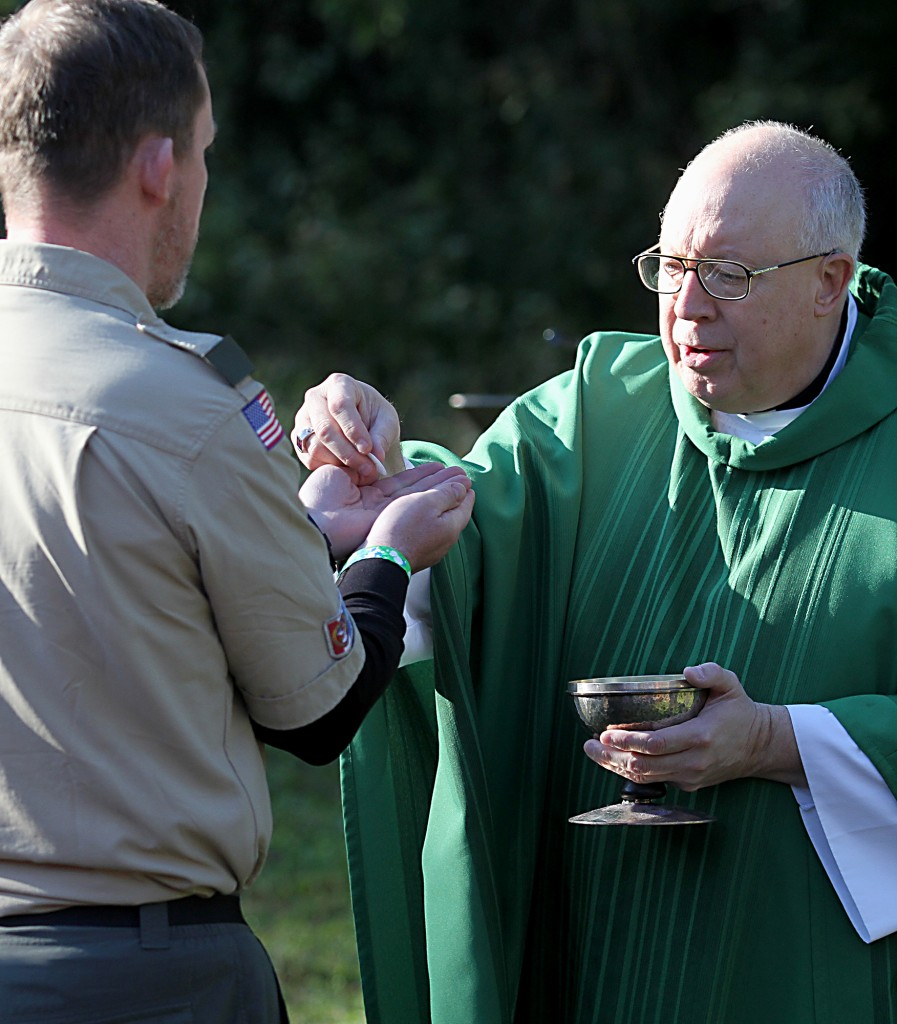 Bishop Joseph Binzer offers the Holy Eucharist during the Peterloon Camporee Mass at Camp Friedlander in Loveland Sunday, October 9, 2016. (CT Photo/E.L. Hubbard)
