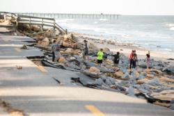 People walk along the historic State Road A1A in Daytona Beach, Fla., Oct. 8 after a portion of it was washed away when Hurricane Matthew hit the coast. (CNS photo/Willie J. Allen Jr., EPA)