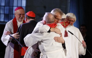The Rev. Martin Junge, general secretary of the Lutheran World Federation, embraces Bishop Munib Younan of the Evangelical Lutheran Church, president of the Lutheran World Federation, front center, during an ecumenical prayer service at the Lutheran cathedral in Lund, Sweden, Oct. 31. At right, Pope Francis embraces Archbishop Antje Jackelen, primate of the Lutheran Church in Sweden. At left is Bishop Anders Arborelius of Stockholm and Cardinal Kurt Koch, president of the Pontifical Council for Promoting Christian Unity. (CNS photo/Paul Haring)