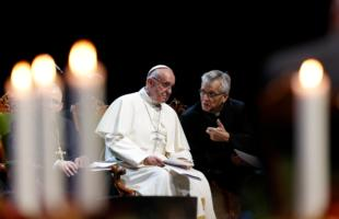 Pope Francis talks with the Rev. Martin Junge, general secretary of the Lutheran World Federation, during an ecumenical event at the Malmo Arena in Malmo, Sweden, Oct. 31. Also pictured is Bishop Munib Younan of the Evangelical Lutheran Church, president of the Lutheran World Federation, left. The event opened a year marking the 2017 commemoration of the 500th anniversary of the Protestant Reformation. (CNS photo/Paul Haring)