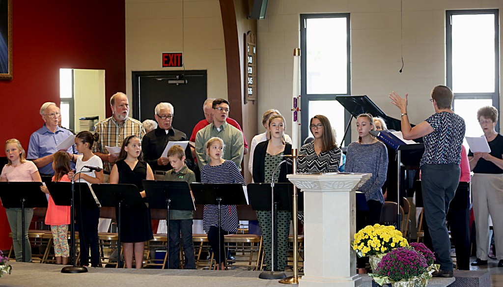 The choir sings during the Queen of Peace Catholic Church 75th Anniversary Mass on Sunday, October 2, 2016, in Millville, Ohio.