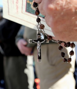 A man holds a Rosary during the 10th Annual Cincinnati Rosary Crusade on Fountain Square Saturday, October 8, 2016. (CT Photo/E.L. Hubbard)