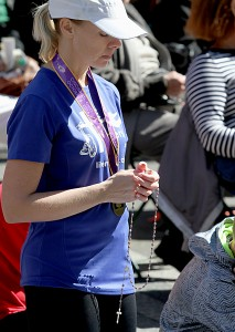 Kindal Farwick prays the Rosary during the 10th Annual Cincinnati Rosary Crusade on Fountain Square Saturday, October 8, 2016. (CT Photo/E.L. Hubbard)