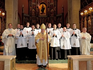 Photo Credit (l to r): Front Row: Bishop Joseph Binzer. Second Row: Father Anthony Brausch, Aaron Hess, John Stein, Edward Hoffmann, K. Scott Morgan, Louis Jacquemin, Father Benedict O'Cinnsealaigh. Back Row: Scott Brand, Elijah Puthoff, Michael Poussard, Kendall Ketterlin, Michael Kopolka, Anthony Marcelli. (Photo by E.L. Hubbard.)
