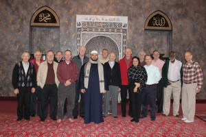 Priests and brothers from Glenmary Home Missioners pose for a photo with representatives from the Islamic Center of Greater Cincinnati Nov. 29 in the center's prayer hall. (Photo Courtesy of Glenmary/John Stegeman)