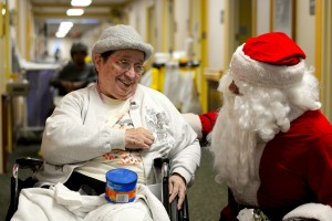 Sister Marjorie Huelsman is all smiles during a visit with Santa at the Maria Joseph Center in Dayton. (Courtesy Photo)
