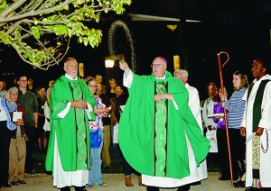 Bishop Joseph Binzer sprinkles Holy Water during a Tree Dedication Ceremony in Memory of Sister Dorothy Stang's Life & Legacy, outside the Bellarmine Chapel on Xavier University's campus in Cincinnati Saturday, Oct. 29, 2016. (CT Photo/E.L. Hubbard)