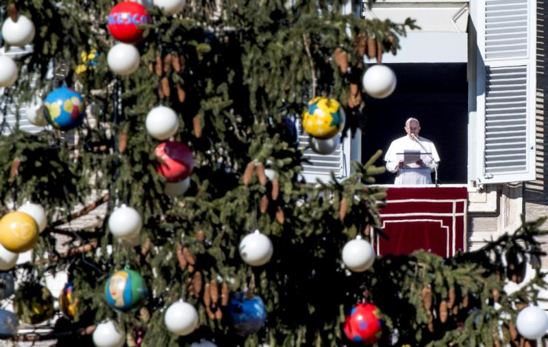 Pope Francis leads the Angelus from the window of his apartment overlooking St. Peter's Square Dec. 18 at the Vatican. (CNS photo/Claudio Peri, EPA)