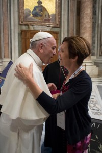 Pope Francis greets Karen Kane, director of the archdiocesan Office of Divine Worship and Sacraments. (Courtesy Photo)