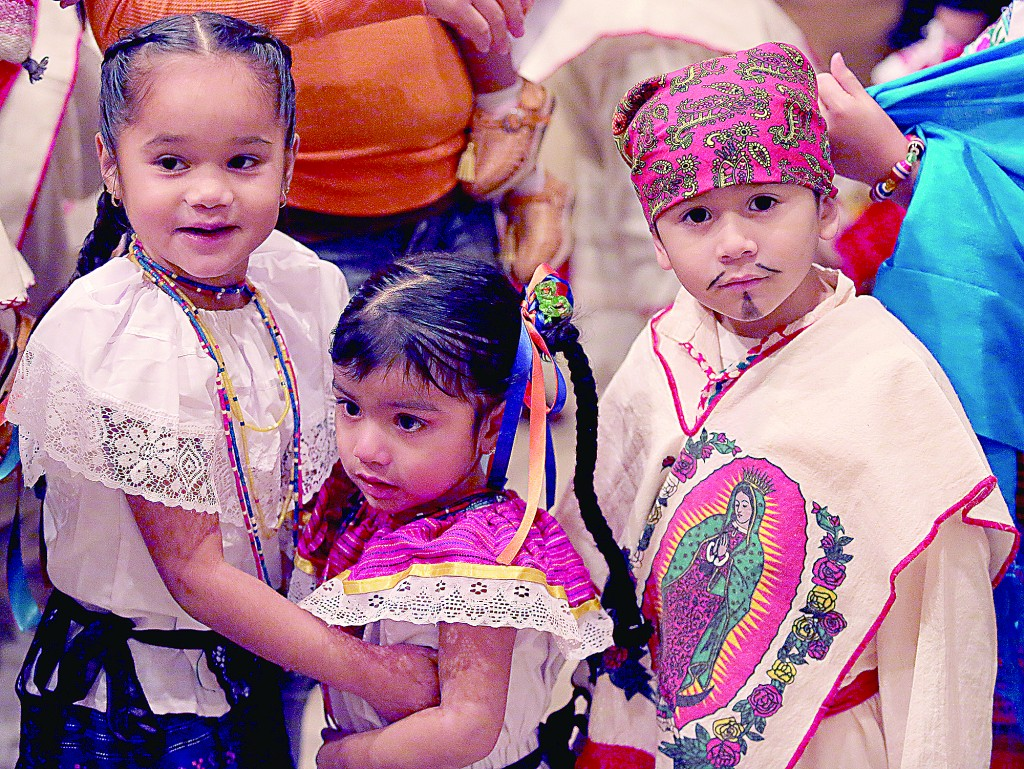 Children wear costumes during the Feast of Our Lady of Guadalupe at St. Julie Billiart parish in Hamilton Sunday, Dec. 11, 2016. The Day of Prayer was to focus on the plight of refugees and migrants across the United States. (CT Photo/E.L. Hubbard)