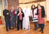Recipients of the Guild's Communicator of the Year award pose with a cutout of Pope Francis. From left: Father. Bob Hater, Dan Andriacco, Michael Pitman, Elizabeth Bookser Barkley,, Marianne Zeleznik, John Keiswetter, Patricia Frey.
