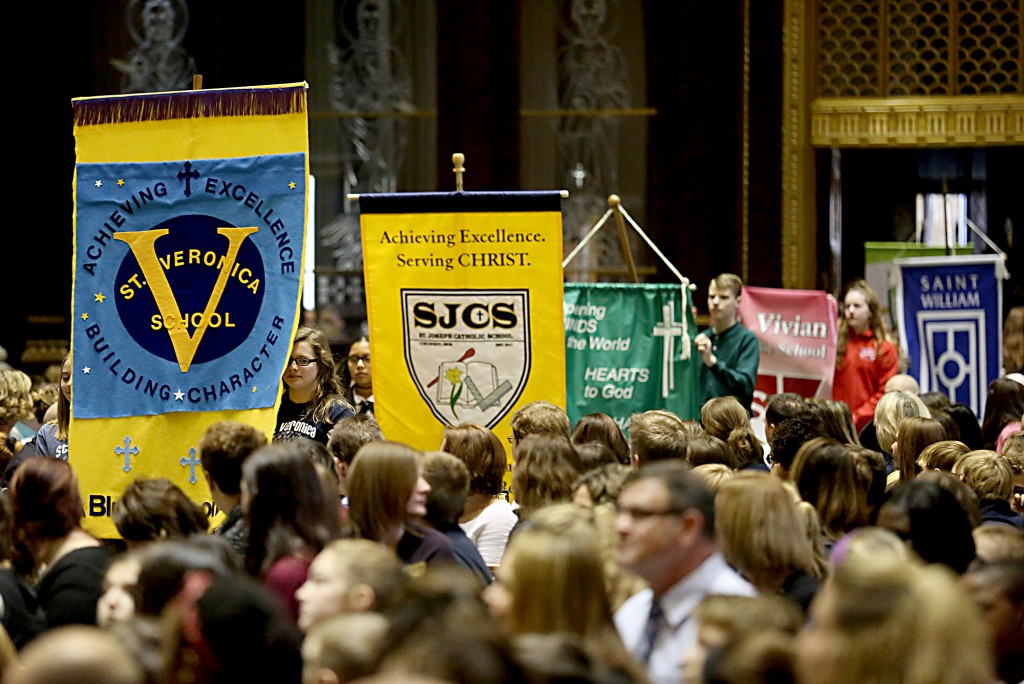 Students carry in their respective school banners during the Catholic Schools Week Mass at the Cathedral of Saint Peter in Chains in Cincinnati Tuesday, Jan. 31, 2017. (CT Photo/E.L. Hubbard)