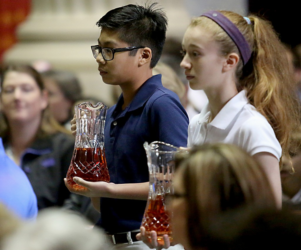 Students carry the Gifts to the Altar during the Catholic Schools Week Mass at the Cathedral of Saint Peter in Chains in Cincinnati Tuesday, Jan. 31, 2017. (CT Photo/E.L. Hubbard)