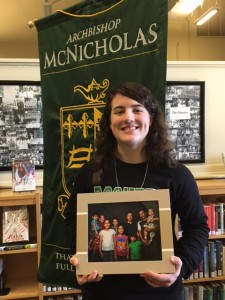 McNicholas senior Christiane Hazzard holds a photo of the Syrian family her parish, Immaculate Heart of Mary, has been assisting. (CT Photo/Sr. Eileen Connelly)