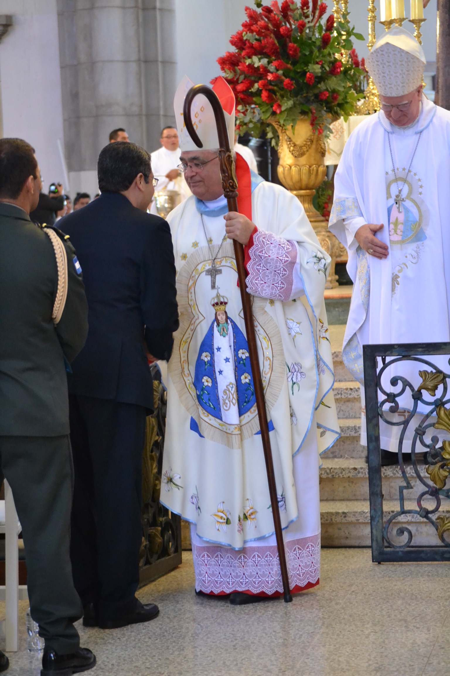 The Panamanian Cardinal who celebrate the official Mass for the Feast of Our Lady of Suyapa, one of three days of hourly Masses at the Basilica, embraces the President of Honduras (CT/Photo by Gail Finke)
