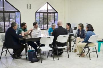 Members of the parish of St. Dominic Salvio explain their parish-wide catechetist training program. (CT/Photo by Gail Finke)