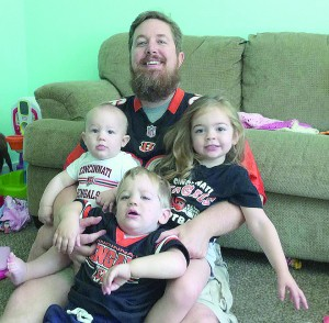 """""""I'm still a big sports fan"""" said Rod Dunlap, pictured in Bengals gear with his children. Dunlap is the head of Sports Ministry, a new focus for the Archdiocese. (Courtesy Photo)"""