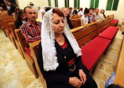 Iraqi Christians pray at Baghdad's Christian Union Evangelical Church Oct. 30. Pope Francis said Nov. 17 that nothing can justify or permit the continued onslaught in the Middle East. (CNS photo/Ali Abbas, EPA) See POPE-GEWARGIS Nov. 17, 2016.