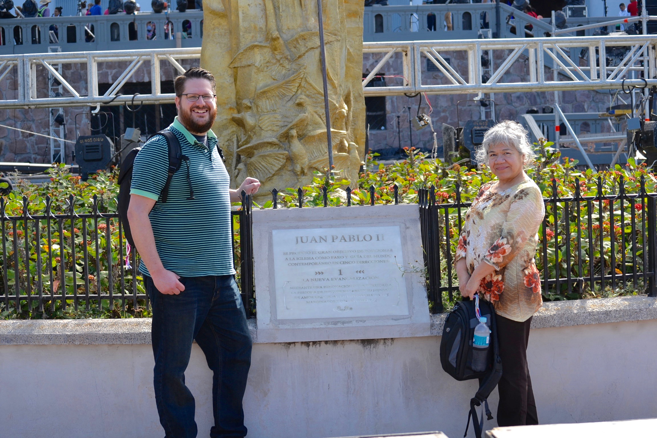 Sean Ater and Dina Beach, whose work involves the New Evangelziation, next to a plaque commemorating Pope St. John Paul's II call for all Catholics to embrace it (CT/Photo Gail Finke)