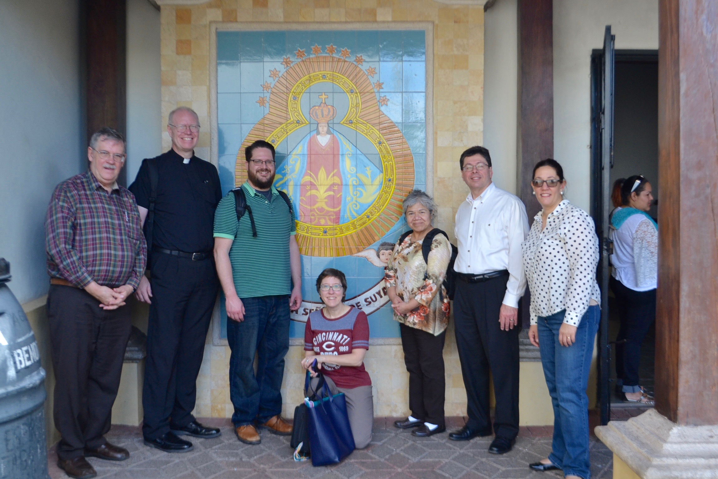 The Archdiocese's six visitors and one of their Honduran hosts at the original church of Our Lady of Suyapa, built in the 1700s (CT/Photo by Gail Finke)