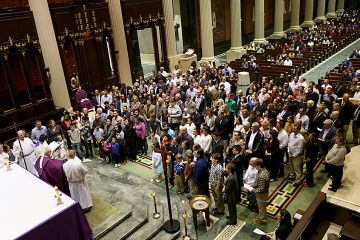 Auxiliary Bishop Joseph Binzer addresses the Catechumens and their godparents during the Rite of Election of Catechumens and of the Call to Continuing Conversion of Candidates who are preparing for Confirmation and Eucharist or Reception into Full Communion with the Roman Catholic Church at the Cathedral of St. Peter in Chains in Cincinnati Sunday, Mar. 5, 2017. (CT PHOTO/E.L. HUBBARD)