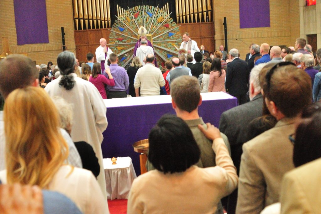 Elias Mwesigye leads the Recessional during the Rite of Election of Catechumens and of the Call to Continuing Conversion of Candidates who are preparing for Confirmation and Eucharist or Reception into Full Communion with the Roman Catholic Church at the Cathedral of St. Peter in Chains in Cincinnati Sunday, Mar. 5, 2017. (CT PHOTO/E.L. HUBBARD)