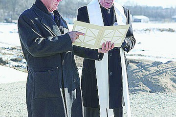 Tony Maas, president and CEO of JTM Food Group, asked Archbishop Dennis M. Schnurr to bless the groundbreaking for the Harrison Company's $26.1 million expansion. (Courtesy Photo)