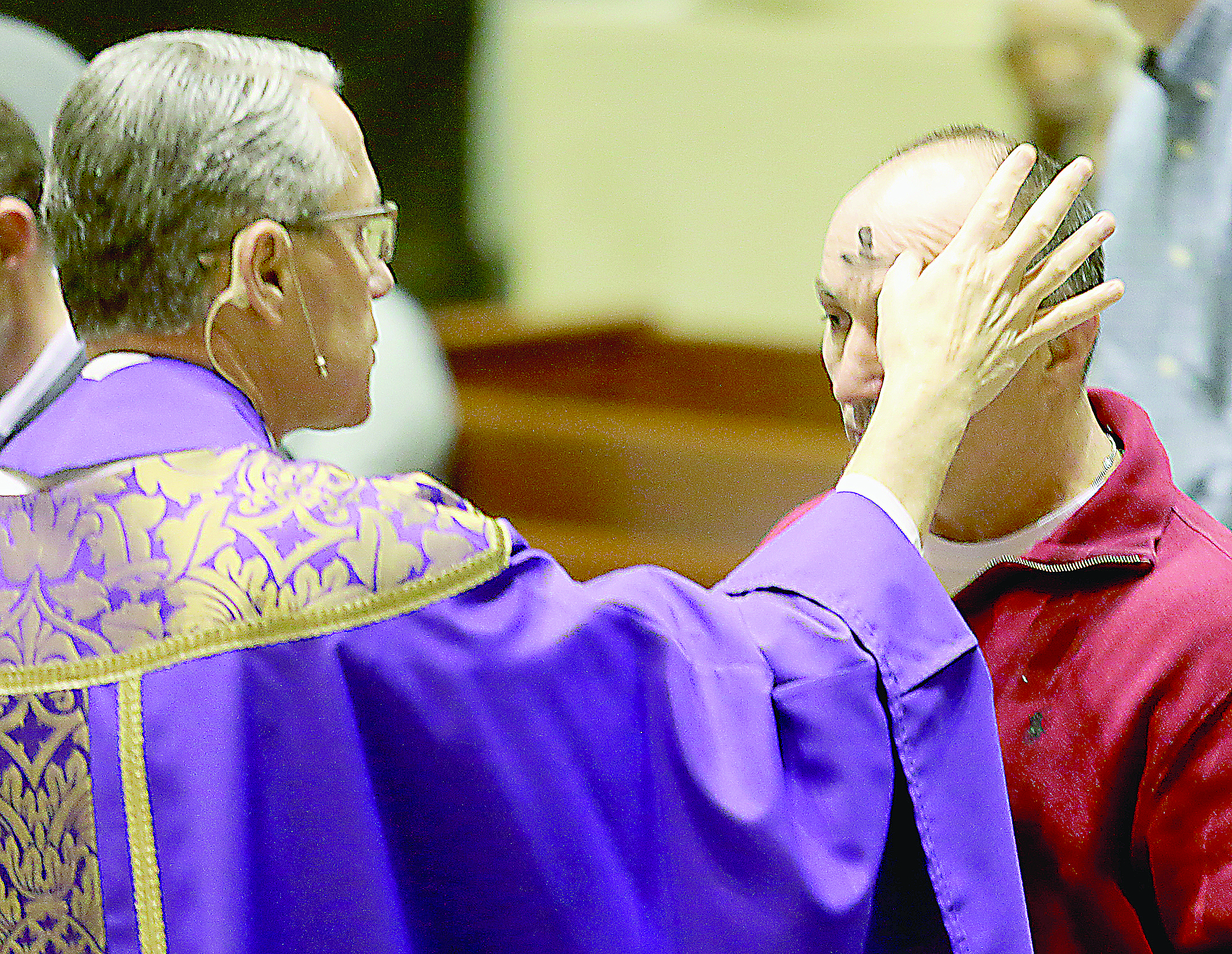 Rev. Raymond Larger marks a parishioner's forehead with the sign of a cross during Ash Wednesday services at St. Peter in Chains Cathedral in Cincinnati Wednesday, Mar. 1, 2017. (CT PHOTO/E.L. HUBBARD)