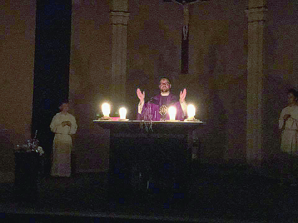 Strong Storms knocked out power to St. Andrew in Milford, so Mass was conducted under candlelight. (Courtesy Photo)