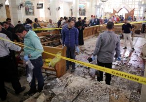 Security personnel investigate the scene of a bomb explosion April 9 inside the Orthodox Church of St. George in Tanta, Egypt. That same day an explosion went off outside the Cathedral of St. Mark in Alexandria where Coptic Orthodox Pope Tawadros II was presiding over the  Palm Sunday service. (CNS photo/Khaled Elfiqi, EPA)
