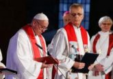 Pope Francis attends an ecumenical prayer service at the Lutheran cathedral in Lund, Sweden, Oct. 31. Also pictured are the Rev. Martin Junge, general secretary of the Lutheran World Federation, and Archbishop Antje Jackelen, primate of the Lutheran Church in Sweden. The pope made a two-day visit to Sweden to attend events marking the 500th anniversary of the Protestant Reformation. (CNS photo/Paul Haring)