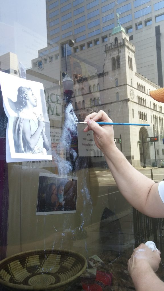 On Holy Saturday, Michael Glass begins his artwork on the Risen Christ. (Greg Hartman/CT Photo)