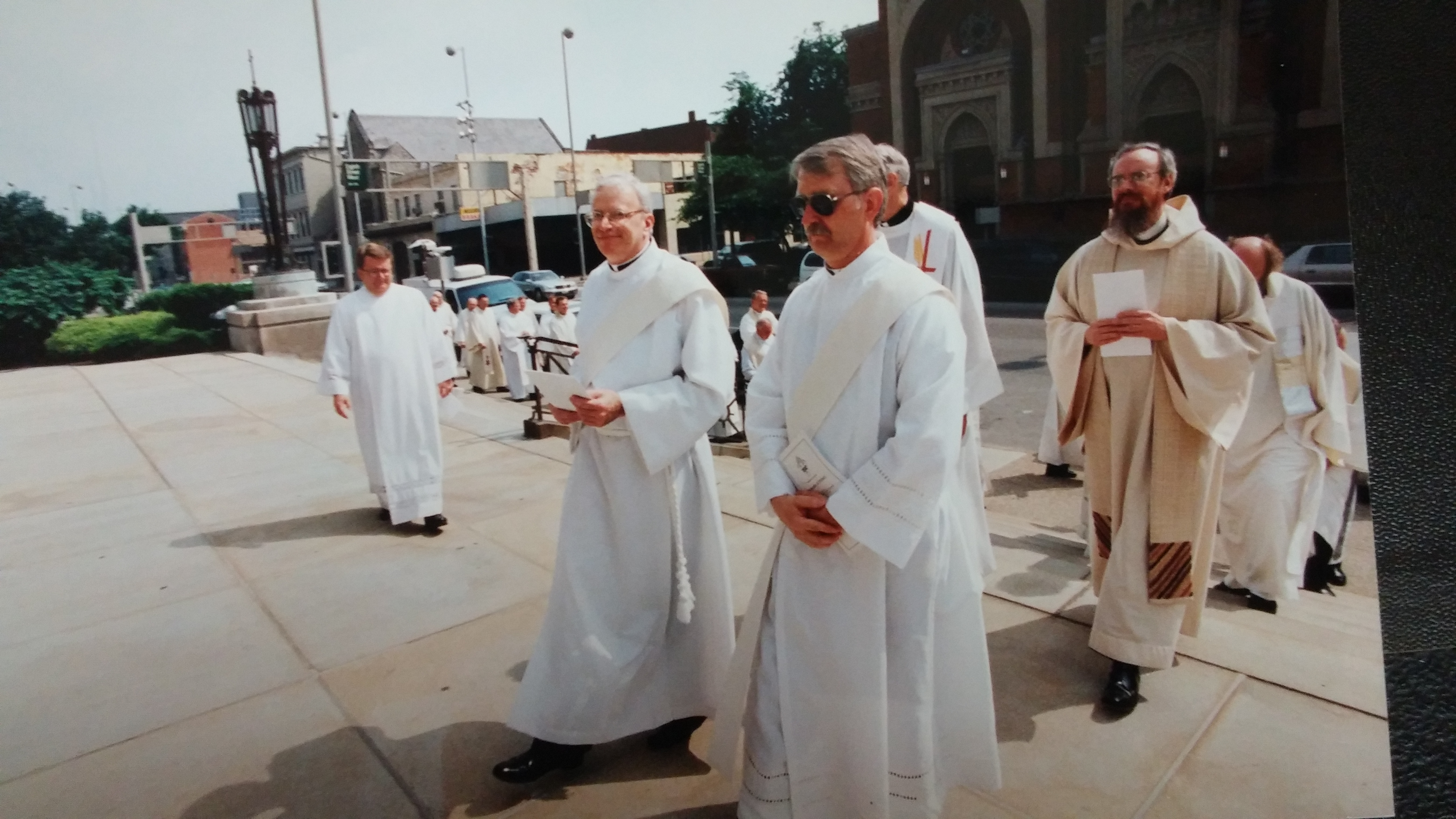 Patrick Welsh and Patrick Sheridan process into St. Peter in Chains Cathedral.