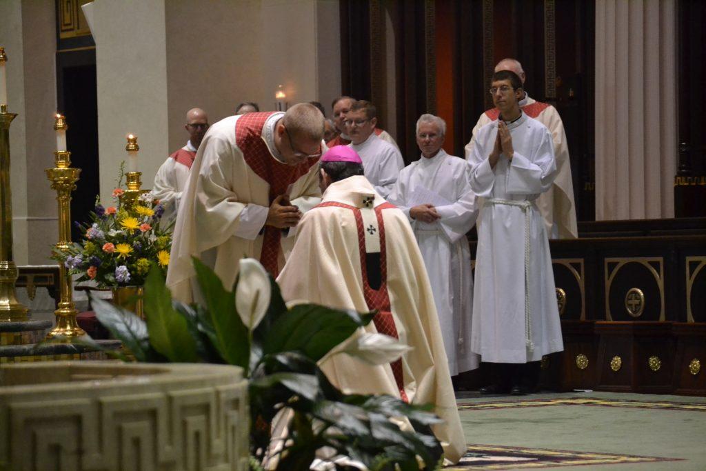 Reverend Doseck prays for Archbishop Dennis M. Schnurr. (CT Photo/Greg Hartman)