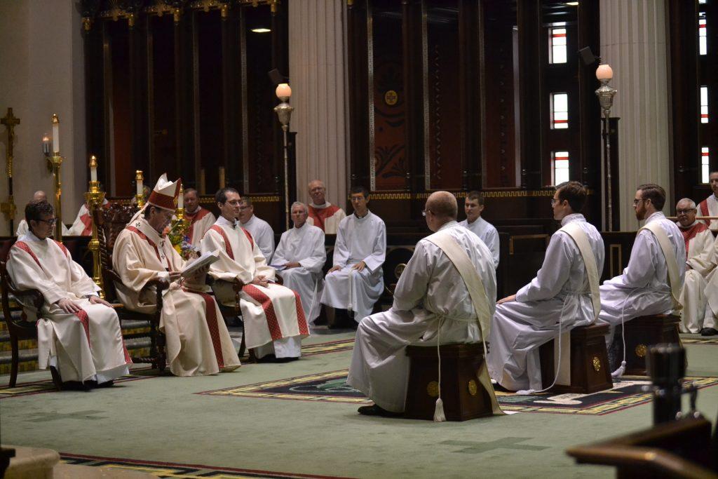 Archbishop Dennis M. Schnurr instructs David Doseck, Peter Langenkamp, Alexander Witt and the celebrating assembly (CT Photo/Greg Hartman)